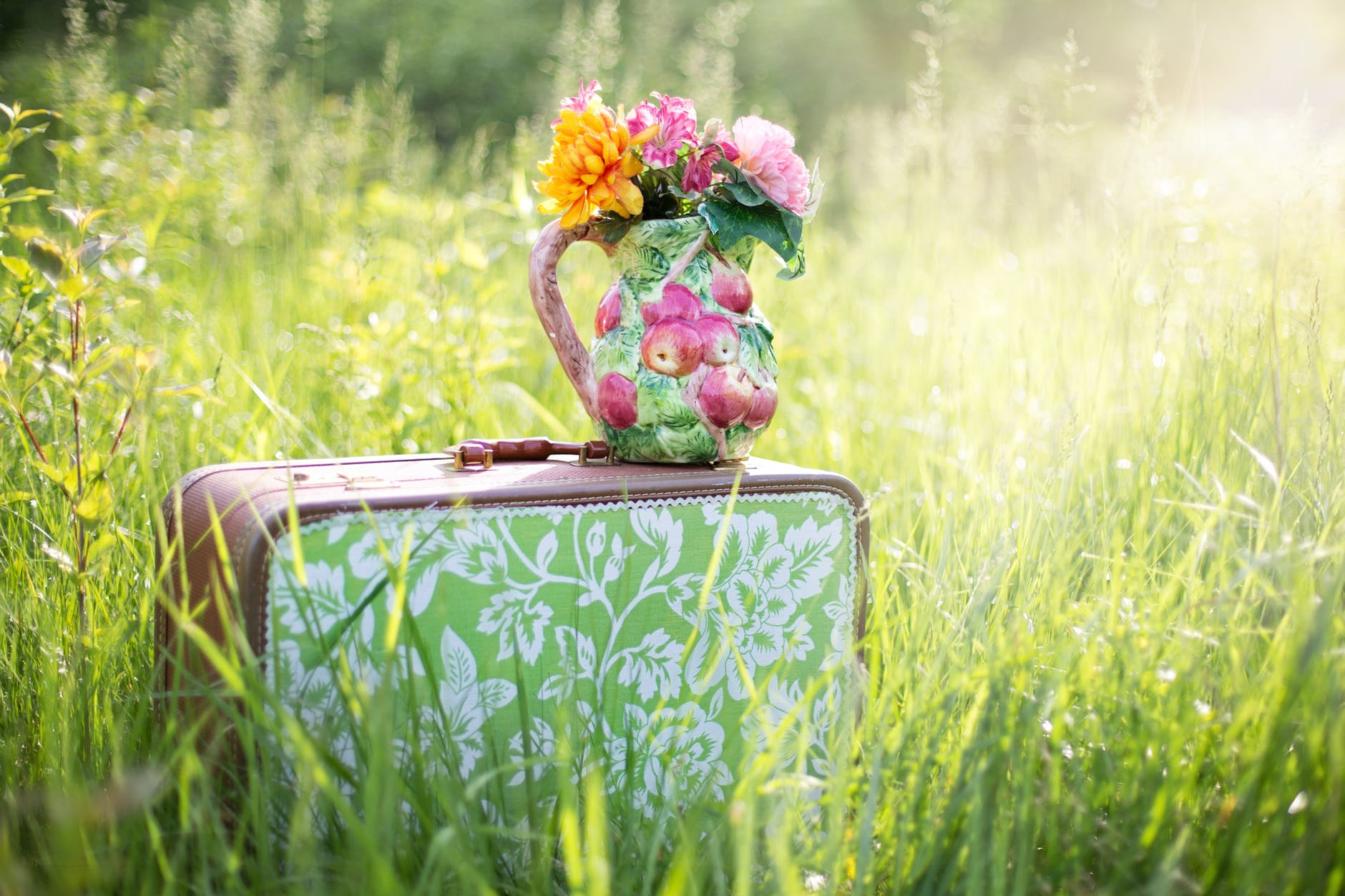 summer-still-life-suitcase-in-field-grass-summer